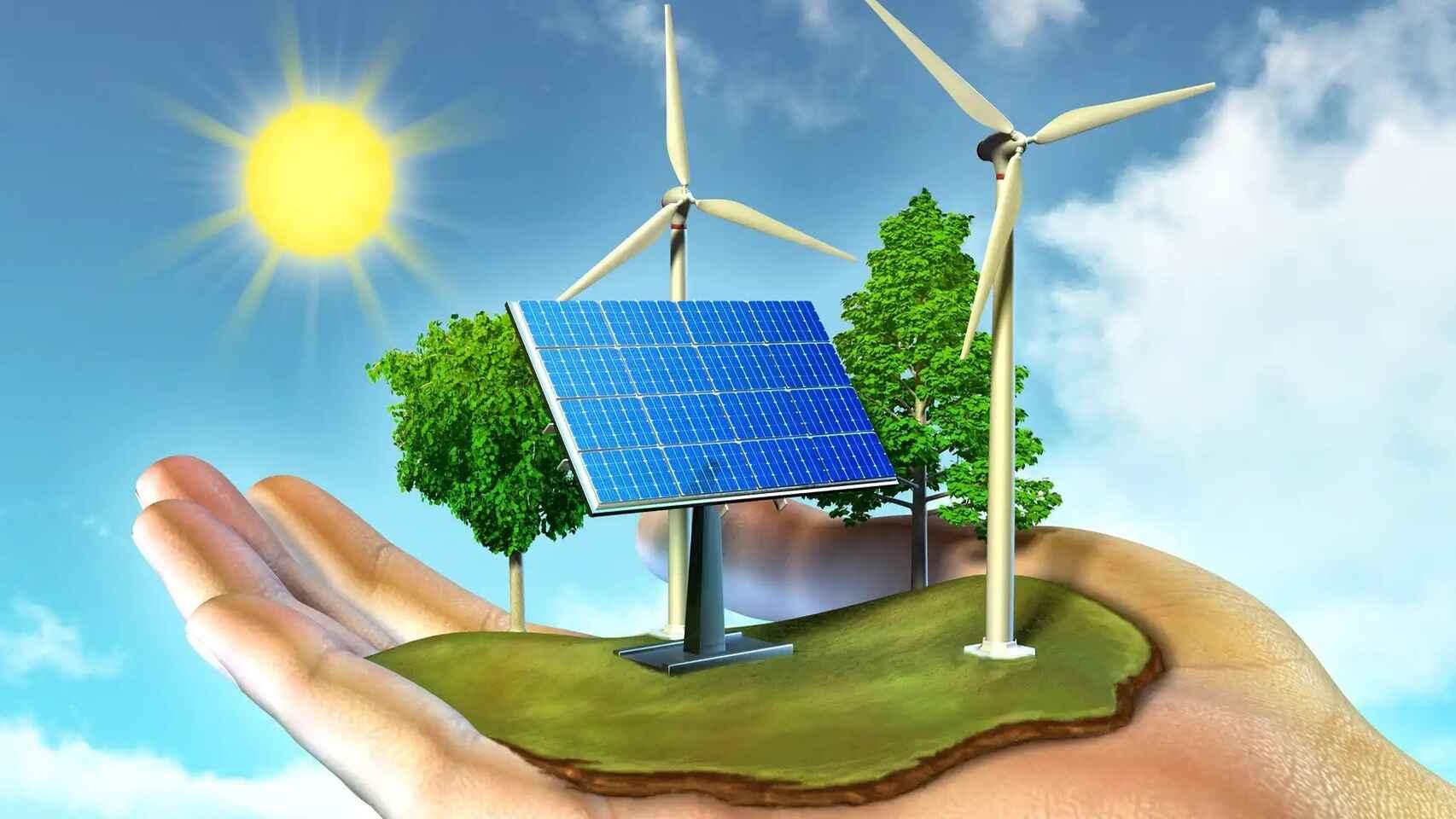 Mano sosteniendo molino eólico, panel solar y árboles
